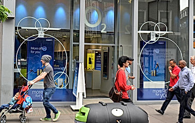 Members of publc walking past o2 window on High Street whilst being tracked by Audience Analytics