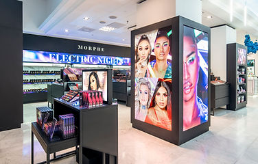 In-store digital media content being displayed within cosmetics department