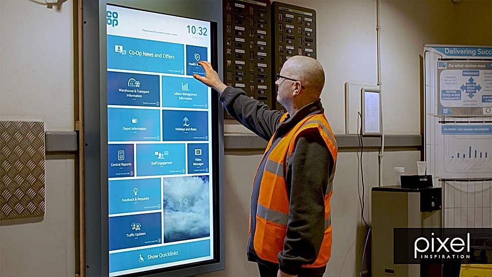 Co-Op employee using interactive notice board to access information about work place communications