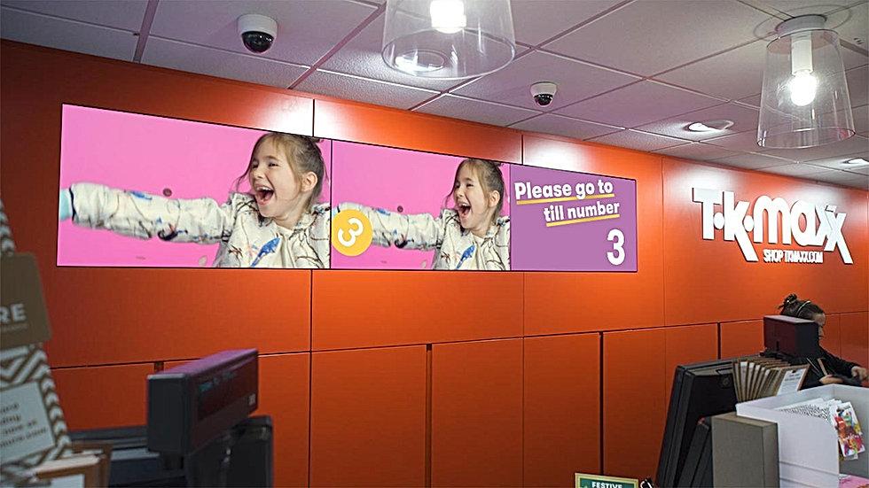 Queue management screens at TK Maxx store