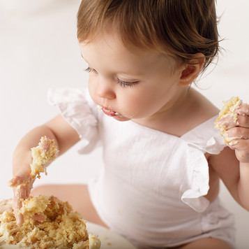 baby mouth full of cake photography