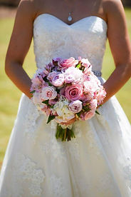 Bride holding a pink and white bouquet. Wedding Flower Designs Athens, Ga