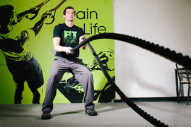 Colin demonstrates the battle ropes.