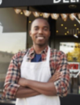 Black male business owner outside coffee