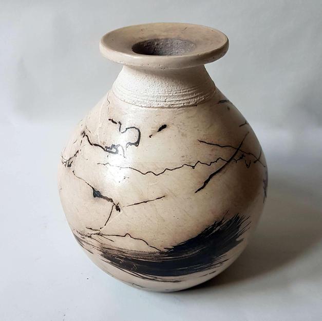 horsehair and feather raku vase