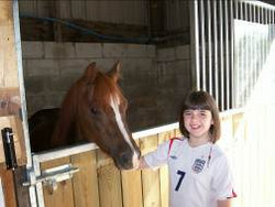 Kid at stables.jpg