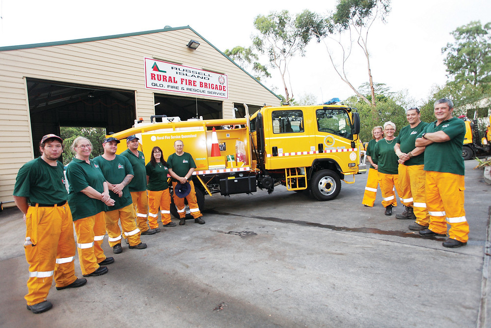 Russell brigade First Officer (right) and the brigade crew with the new Isuzu fire engine!