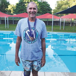 SIX MEDALS FOR  ISLAND SWIMMERS