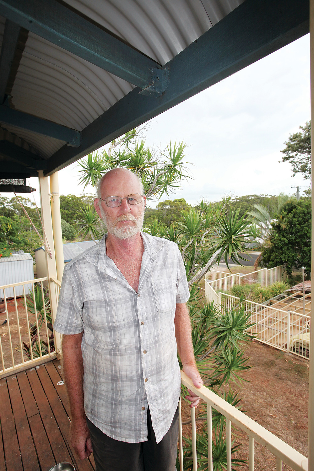 Nick Brackstone on the verandah of his Russell Island home