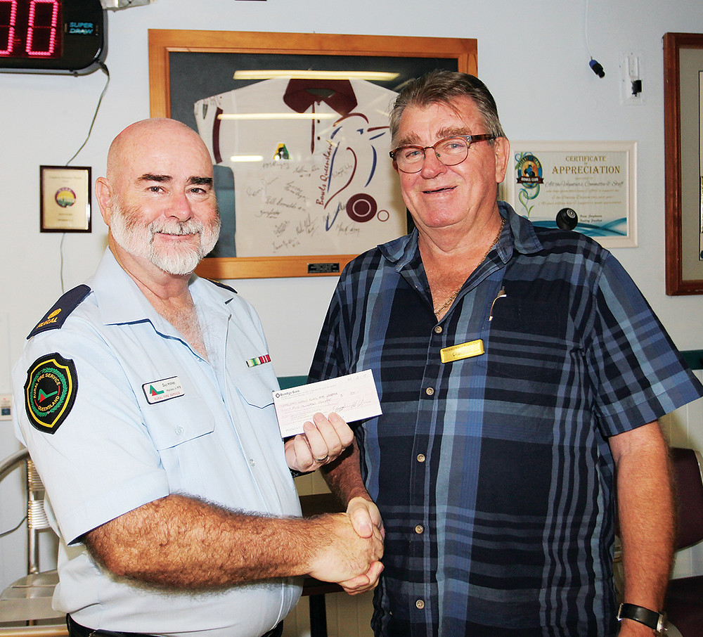 Club Macleay chairman Rod Callaghan hands of the $500 cheque to 2nd Officer Guy Hickey