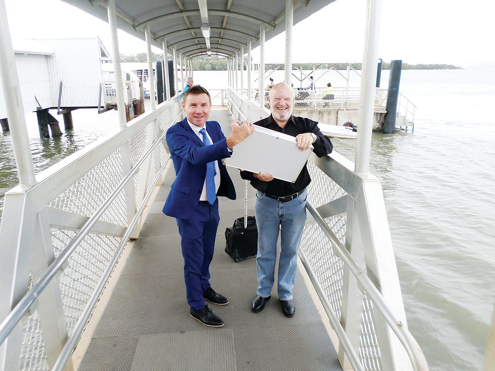 Andrew Laming is pictured with Col McGinnis, vice president of SMBI Chamber of Commerce at the announcement on the Russell Island jetty