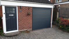 Trojon roller door in anthracite grey with a 250mm box