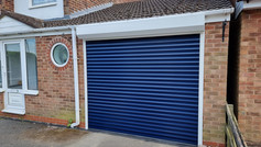 Trojon roller door in steel blue with white guides and box