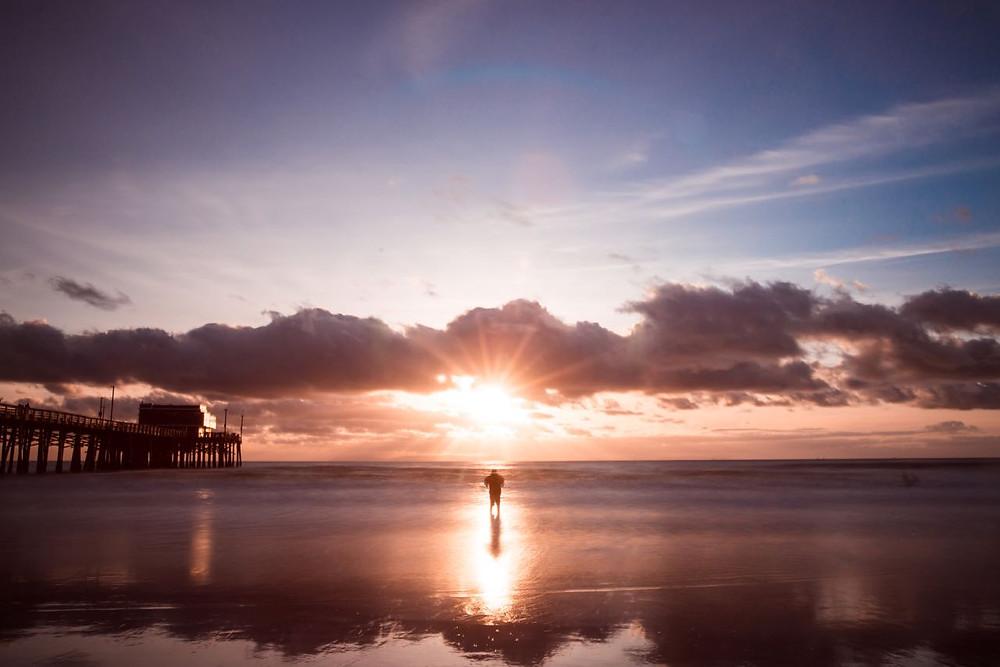 Long exposure sunset silhouette in Newport beach