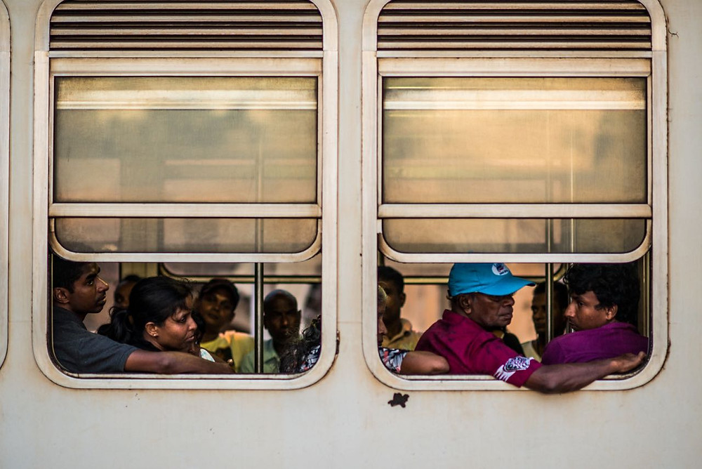 Sri Lankans on the coastal train in Colombo