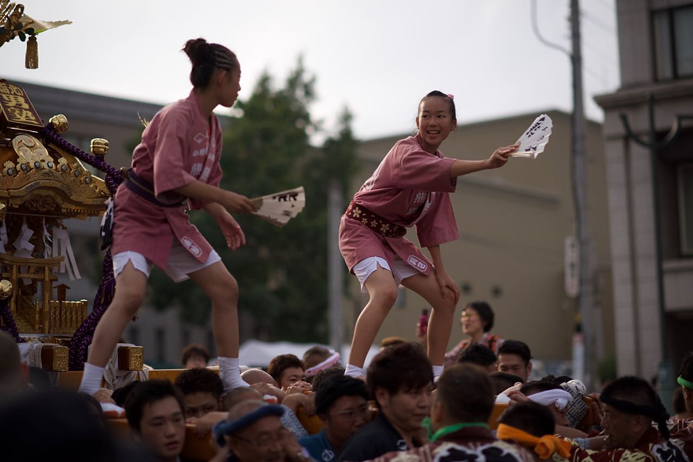 Girls performing at summer festivals in Hokkaido, Japan