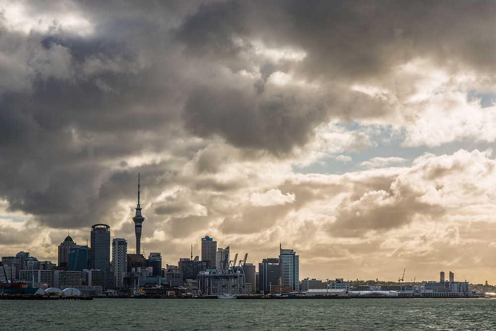 Downtown Auckland on a cloudy day shot from Ferry on the way to Waiheke Island
