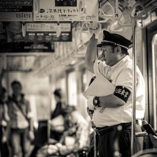 Japanese train conductor in train