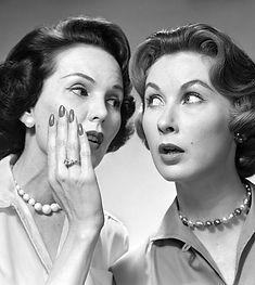 Two yentas gossiping. One looks remarkably like Vivian Vance (Ethel Mertz)