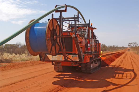 Wheel Trencher with fiber optic cable