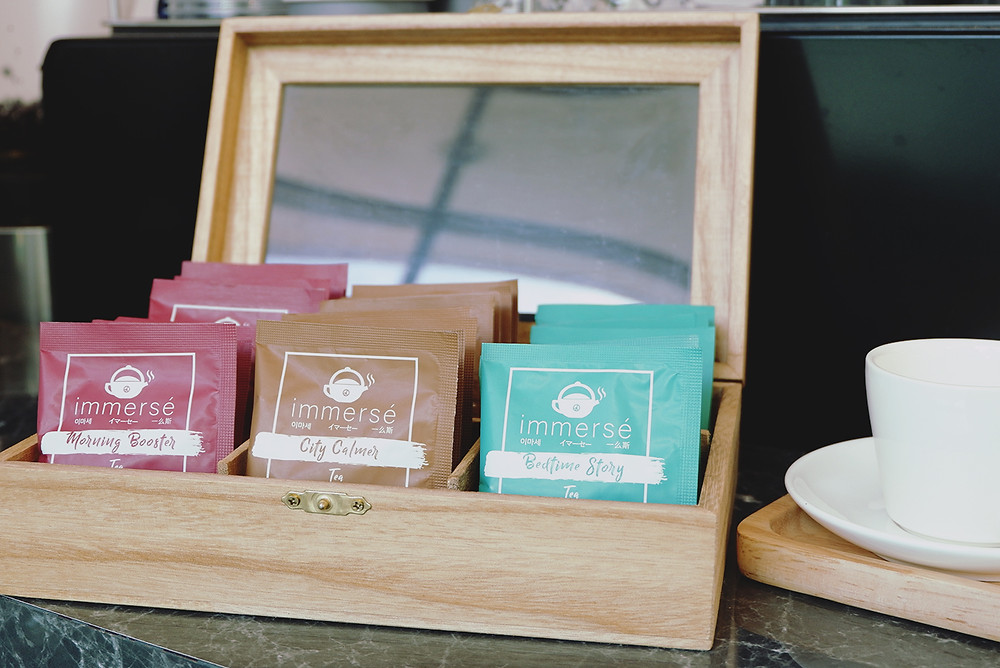 immersé tea sachets in wooden box, Morning Booster, City Calmer, Bedtime Story from left to right