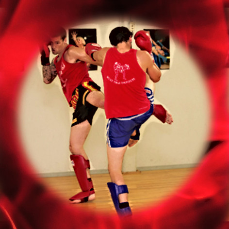 Muay Thai students practice technique