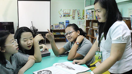 CLSI Students in Gradeschool Library with Teacher Kapitolyo School Pasig
