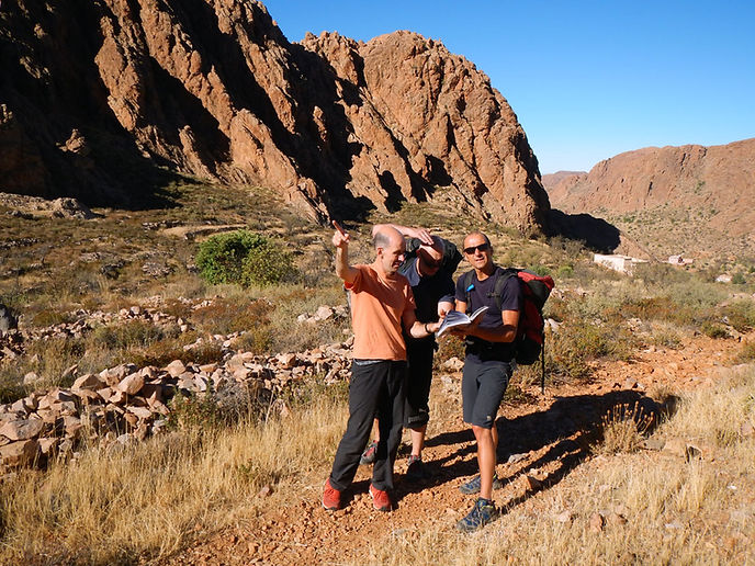 Climbers checking map in search of a route