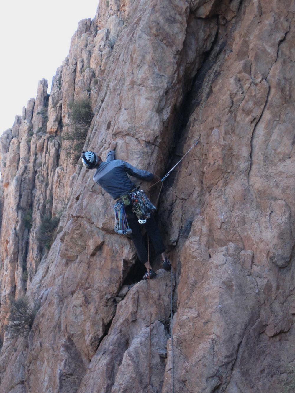 Climber on loose block