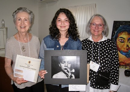"""Pat Castagna (left) and Jackie Pittman (right) of the Beaufort Woman's Club with Betsy Molina of West High School, who won three awards for her photograph """"Lost Boy."""""""
