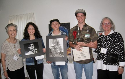 (Left to right) Pat Castagna (Beaufort Woman's Club Art Competition co-chair), Betsy Molina, West High School (first place in photography), Curren Connor, West High School (first place in drawing), Ryan Wheeler, Croatan High School (second place in clay), and Jackie Pittman (Beaufort Woman's Club Art Competition co-chair).