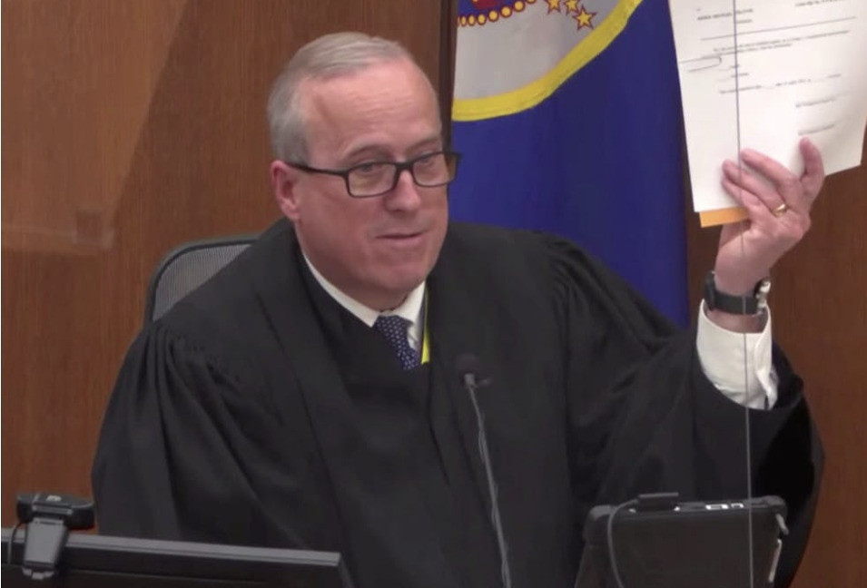 Hennepin County Judge Peter Cahill shows the verdict sheets to the unanimous jury on Monday