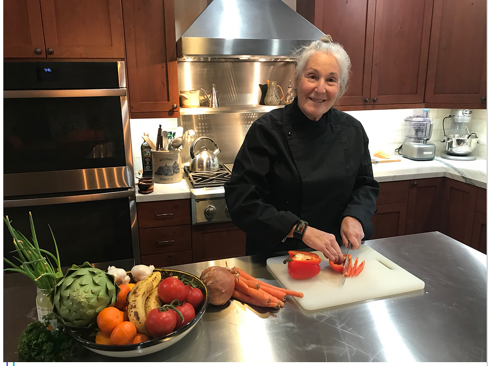 """Bonnie Fishman in her California """"barn"""" kitchen. She insisted on a stainless island, replicating her previous commercial kitchens"""