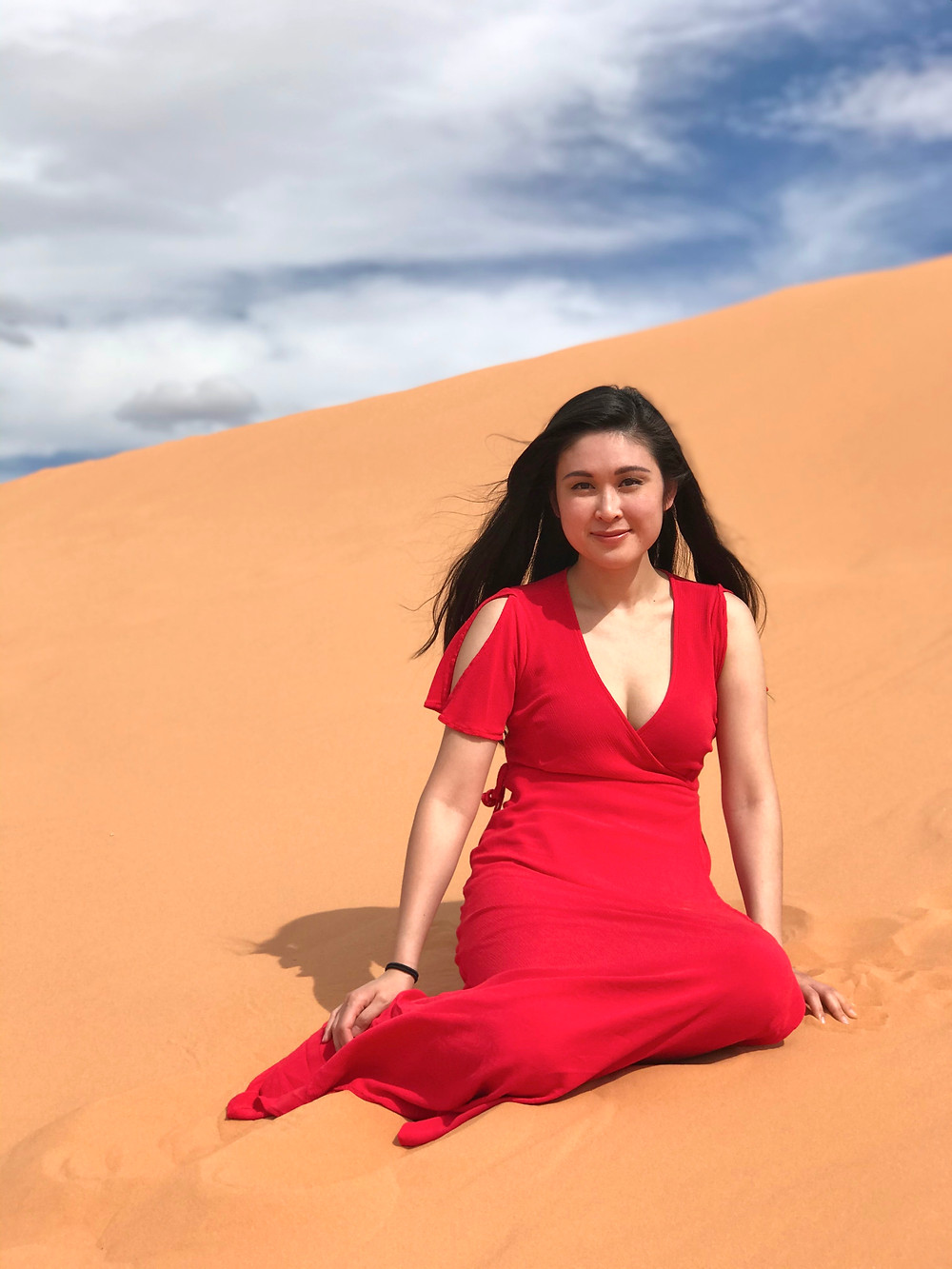 Sitting on the sand in Coral Pink Sand Dunes