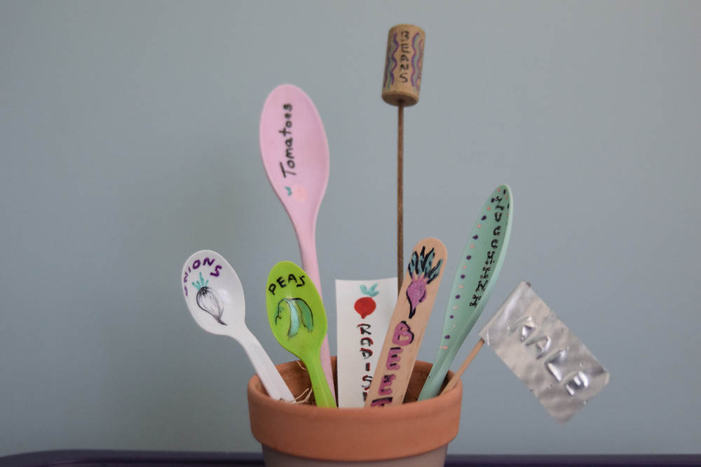A variety of homemade garden labels
