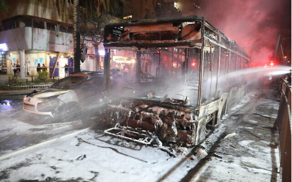 Bus destroyed by a rocket on the Holon street on May 11, in the area shown below in the Dzodin photos (Noam Revkin Fenton/Flash90)