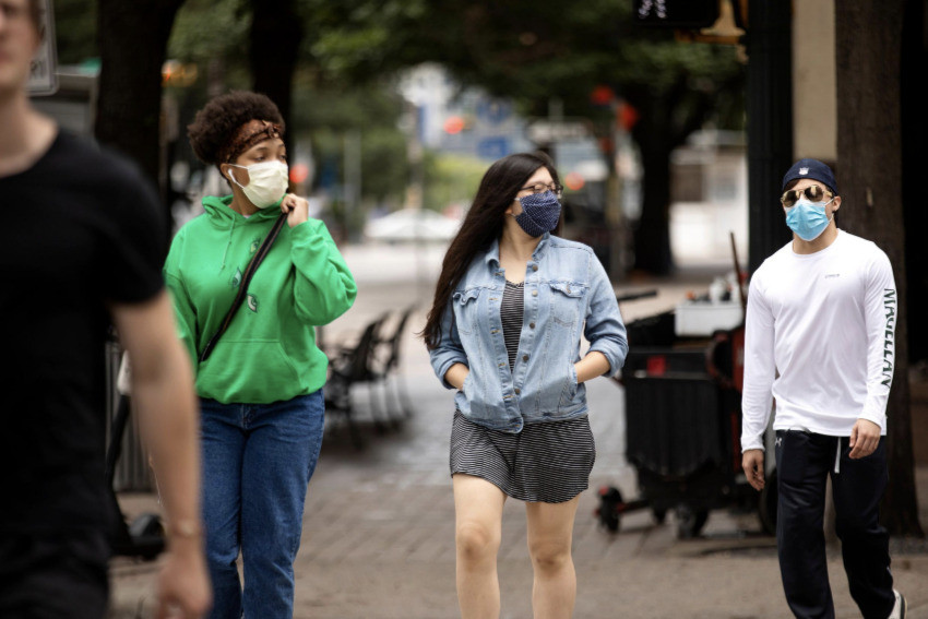 Masked pedestrians in Austin last June. Covid rates remain alarmingly high in Texas