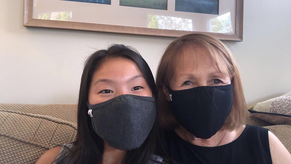 Laura and Lina Berman, masked