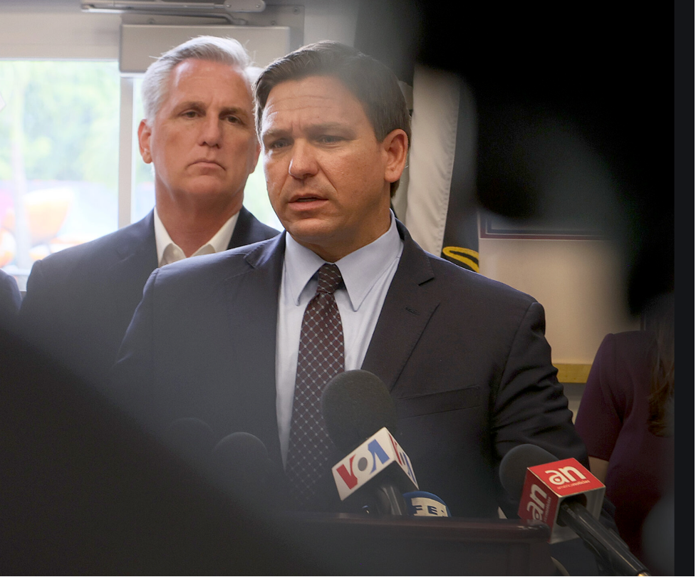 Despite rising Covid cases in his state, Fla. Gov. Ron DeSantis (center, with Kevin McCarthy) has met ire with fire