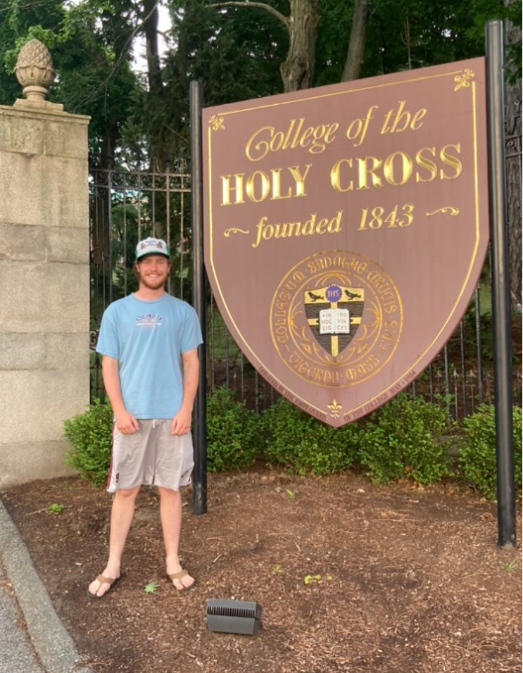Barry in front of the campus entrance in 2019