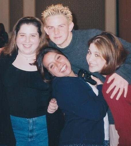 Teenage Emmy at 16 years old, hanging out with theater friends