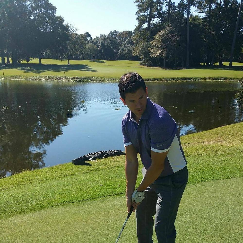 Polit dodging an alligator on the golf course in Myrtle Beach
