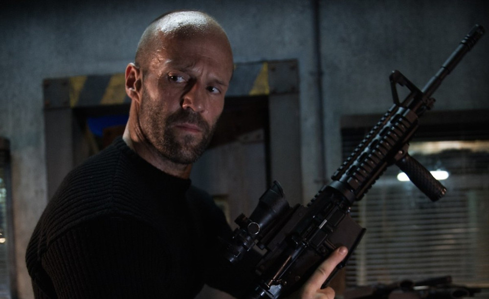 Jason Statham locks and loads in Guy Ritchie's Wrath of Man, now in theaters