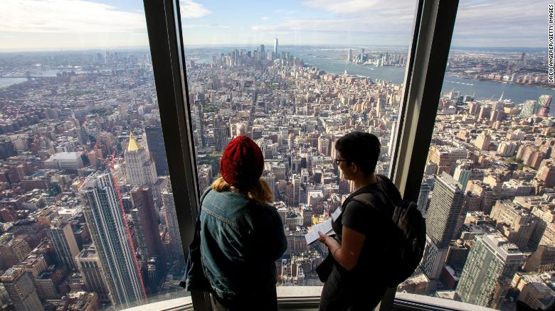 Visitors look toward Lower Manhattan from the 102nd floor observatory of the Empire State Building