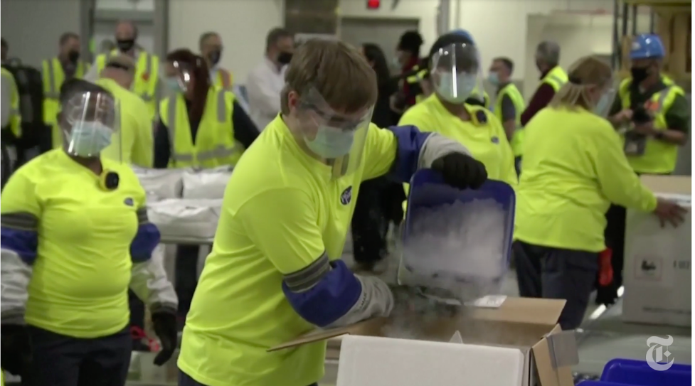 Pfizer workers in Portage Mich. packed precious vials of the company's vaccine in dry ice on Sunday