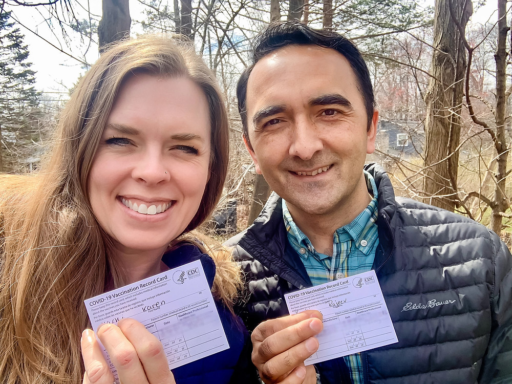 Michiganders Karen and Rajeev Karki proudly display their vaccine cards
