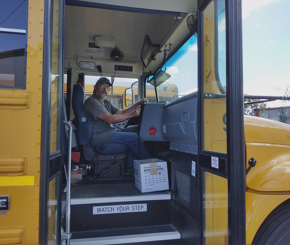 The courageous author at the wheel of his school bus