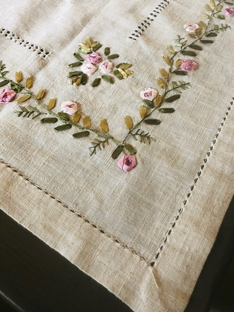 Hand embroidered cloth from Corfu, Greece. This small cloth will serve as a topper to show off the edges.