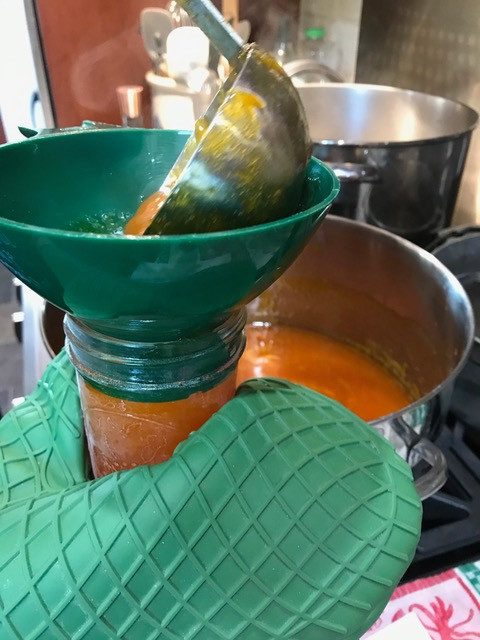 Ladle into jars using a wide mouth funnel and hot pads
