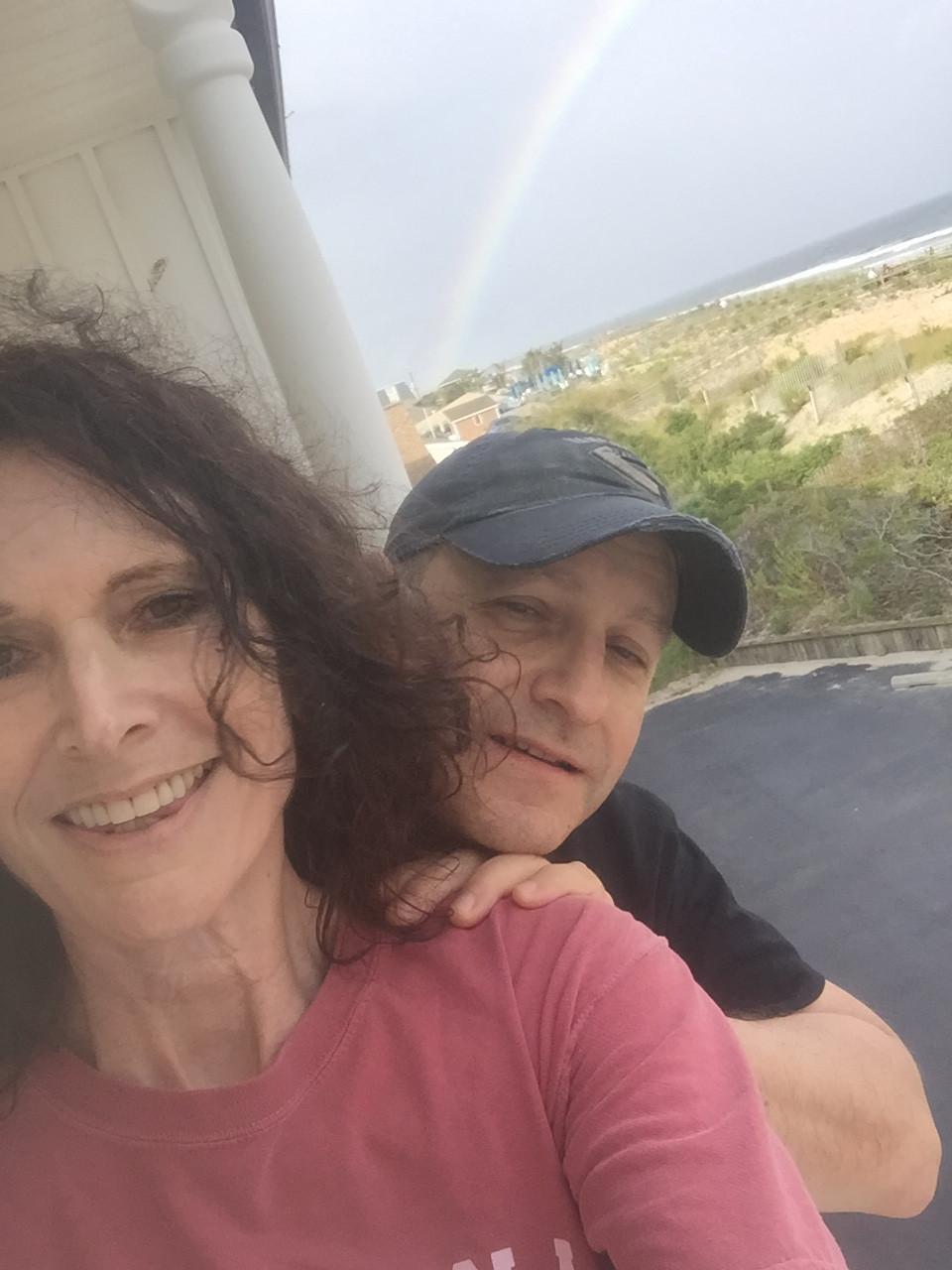 Naomi & Lew Serviss and post-storm rainbow